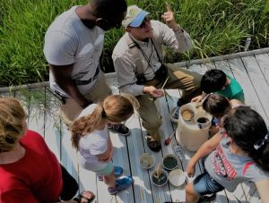 group of kids explores nature with a guide